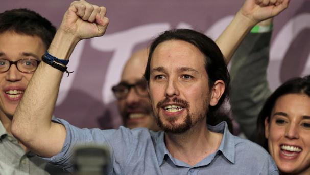 Podemos leader Pablo Iglesias celebrates the party's third place with supporters in Madrid (AP)