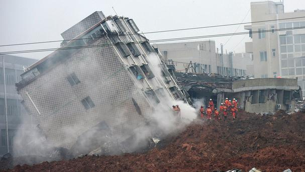 Rescuers search for survivors at a collapsed building in Shenzhen (Chinatopix/AP)