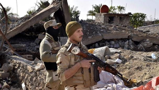 Iraqi soldiers advance their position in northern Ramadi (AP)