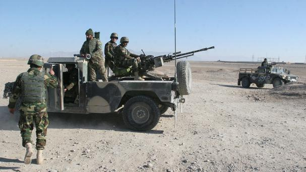 Afghan National Army soldiers guard at a checkpoint on the way to the Sangin district of Helmand province (AP)