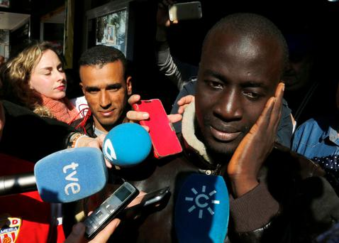 Senegalese man Ngame celebrates his win in Spain