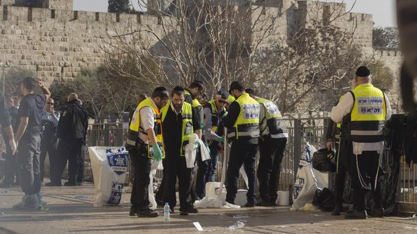 Police officers at the site of an attack outside Jerusalem's Old City on Wednesday - the violence has continued (AP)
