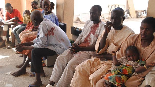 Victims of a Boko Haram attack wait for treatment at a hospital in Maiduguri, Nigeria (AP)