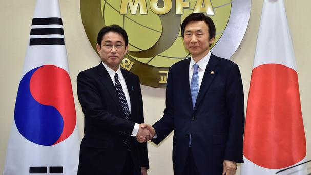 South Korean foreign minister Yun Byung-Se, right, and his Japanese counterpart Fumio Kishida at the start of their meeting (AP)