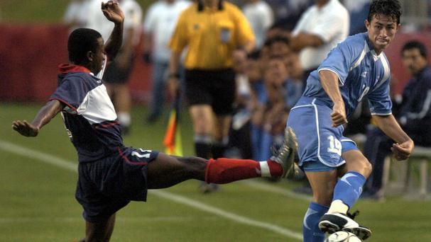 El Salvador's Alfredo Pacheco, right, pictured in 2004 playing against Haiti in an exhibition match in Houston (AP)