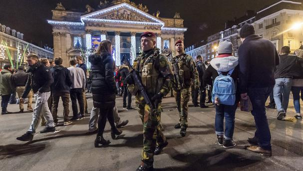 Soldiers patrol as people celebrate New Year's Eve in the historic centre of Brussels (AP)
