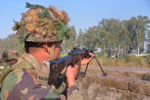 Indian army soldiers take up position on the perimeter of the airforce base in Pathankot. Photo: Getty