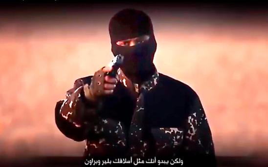 A still from the Isil video of the terrorist with a British accent brandishing a short arm. Photo: PA