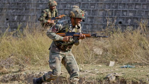 Indian soldiers search a forest area outside Pathankot air force base (AP)