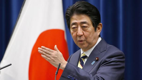 Prime minister Shinzo Abe says there must be a summit in order for to forge a peace treaty with Russia (AP)