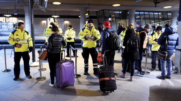 Security staff check IDs at Kastrups train station outside Copenhagen, Denmark (Bjorn Lindgren/TT News Agency/AP)