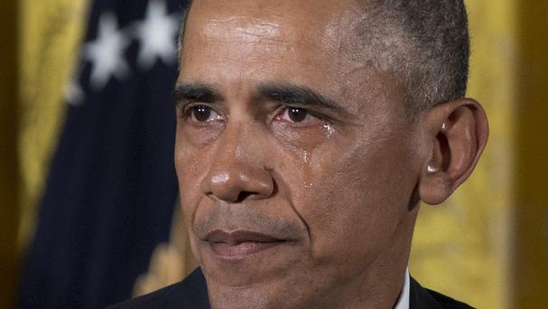A tear rolls down President Barack Obama's face as he unveils his gun control plans at the White House (AP)