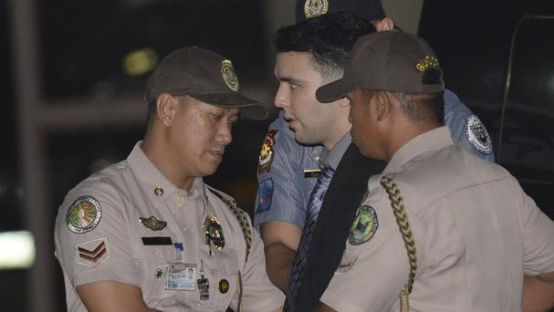 US Marine Lance Cpl. Joseph Scott Pemberton, centre, is escorted to his detention cell upon arrival at Camp Aguinaldo in suburban Quezon city, north-east of Manila, Philippines (Ted Aljibe/Pool Photo via AP)