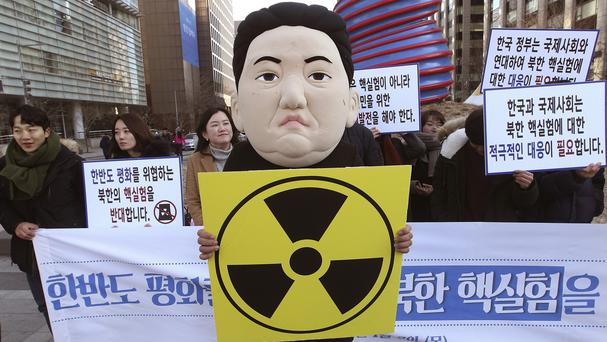 A South Korean student wearing a mask depicting North Korean leader Kim Jong Un participates in a rally after the announcement of a hydrogen bomb test (AP)
