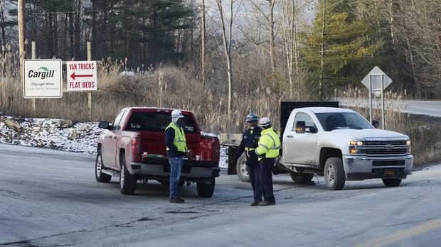 Authorities guard the road to the Cargill salt mine during the rescue of 17 mine staff in Lansing, New York (AP)
