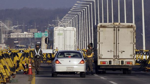 South Korean soldiers at a check point at Unification Bridge in Paju, as Seoul resumed broadcasting anti-Pyongyang propaganda (AP)