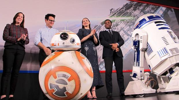 Producer Kathleen Kennedy, director JJ Abrams, actress Daisy Ridley and actor John Boyega with BB-8 and R2-D2 at a press conference in Shanghai (AP)