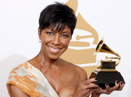 Natalie Cole holding a Grammy