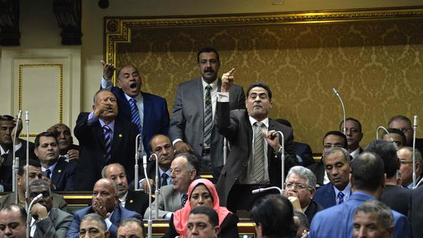 Members of Egypt's parliament attend the inaugural session, the first to convene in three years, in Cairo (AP)