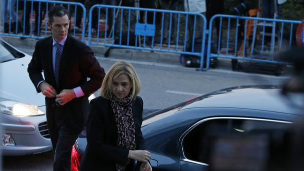 Spain's Princess Cristina and her husband, Inaki Urdangarin, arrive at court in Palma, Majorca (AP)