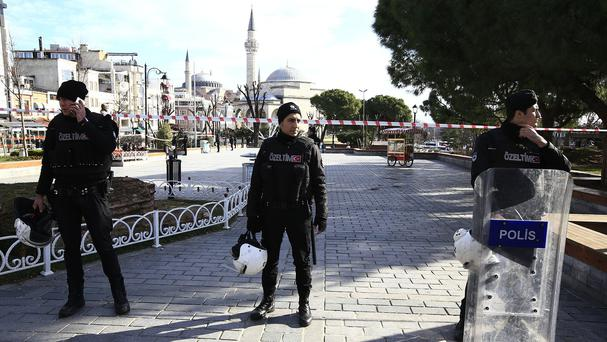 Policemen secure an area at Istanbul's historic Sultanahmet district after an explosion (AP)