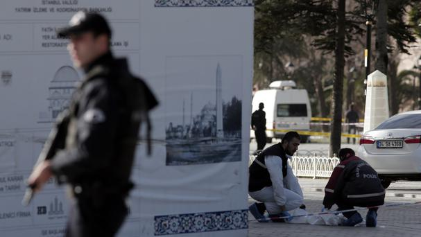 Police search for evidence in the Sultanahmet district after an explosion in Istanbul (AP)