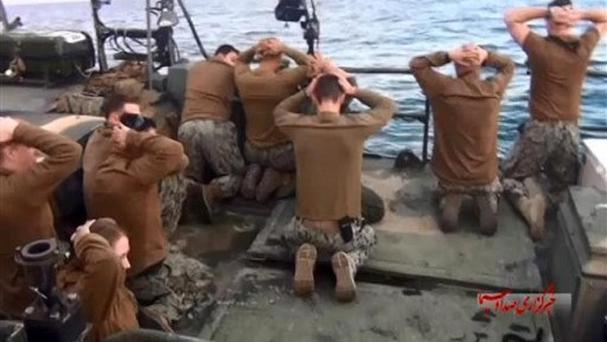 Picture released by the Iranian state-run IRIB News Agency shows detention of US Navy sailors by the Iranian Revolutionary Guards in the Persian Gulf. (Sepahnews via AP)