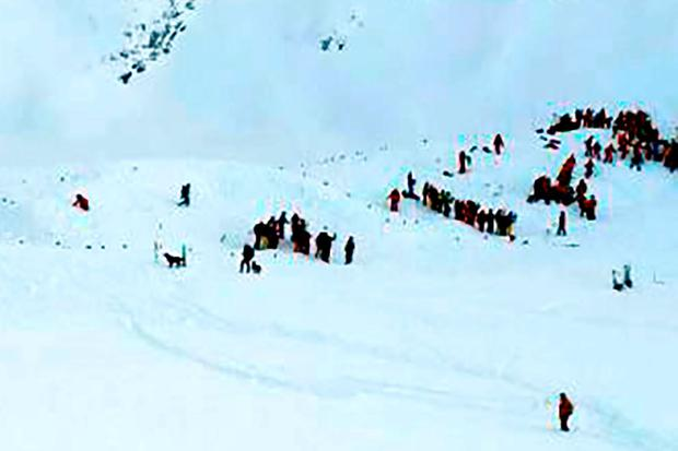 Rescue teams search the avalanche site. Photo: AFP/Getty