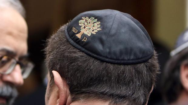 A member of the Jewish authority waits outside a synagogue in Marseille (AP)
