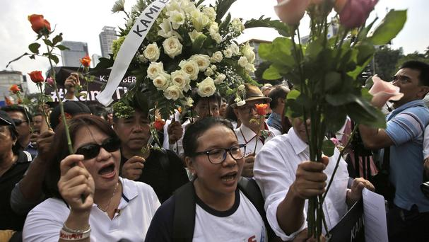 Activists during a rally condemning Thursday's Islamic State attack in Jakarta (AP)