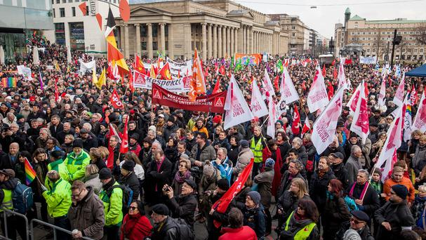 Peple gather in the centre of Stuttgart, Germany, during a rally to support refugees (Christoph Schmidt/dpa via AP)