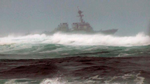 A search vessel cruises the waters off the beach at Haleiwa (AP)