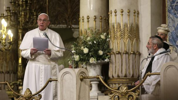 Pope Francis is flanked by Rabbi Riccardo Di Segni (right) as he delivers his speech during his visit to the Great Synagogue of Rome (AP)