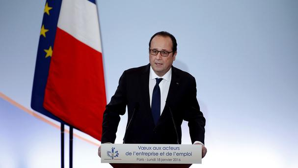 French president Francois Hollande delivers his speech as he presents his New Year greetings to Employment and Unions forces at the Economic, Social and Environmental Council in Paris (AP)