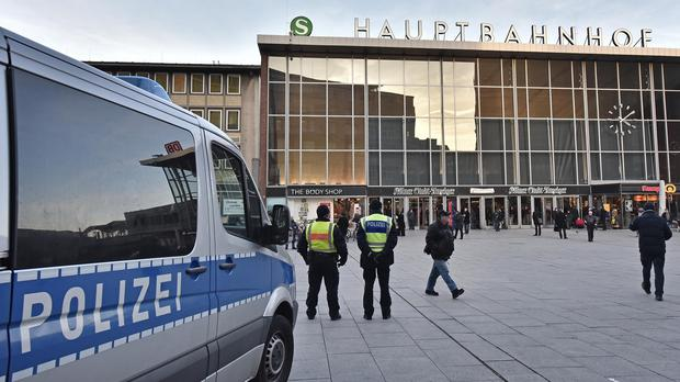 Police patrol in front of the main train station in Cologne, Germany (AP)
