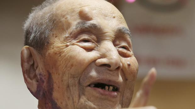 Yasutaro Koide, pictured when he was formally recognised as the world's oldest man by the Guinness World Records, has died aged 112 (AP)