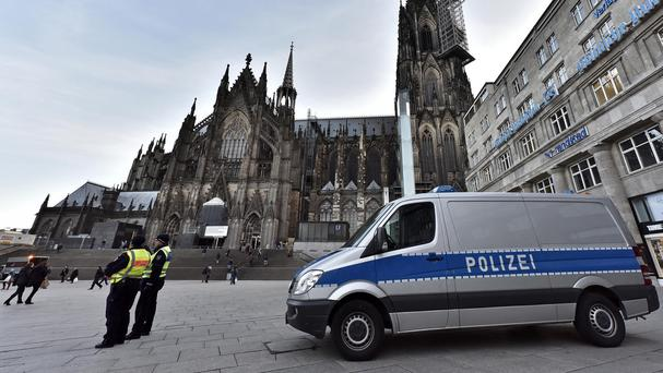 Police patrol in front of the main train station and the cathedral in Cologne, Germany (AP)