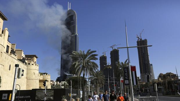 The fire burning at the hotel in Dubai (AP)
