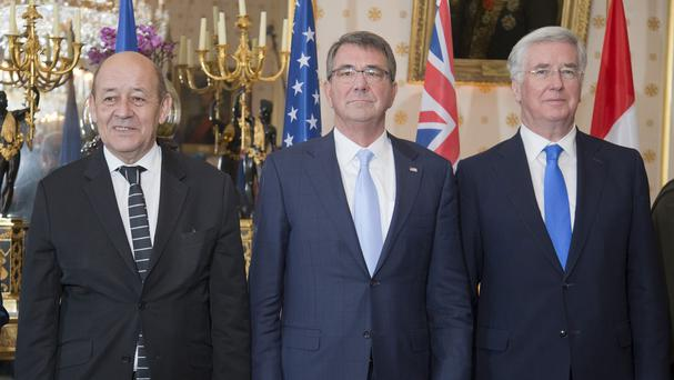 French defence minister Jean-Yves Le Drian with US defence secretary Ash Carter and the UK's Michael Fallon (AP)