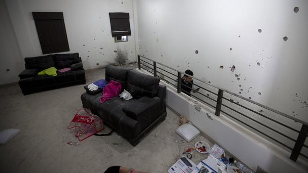 Bullet holes riddle the walls of the home that Mexican marines raided in their search for drug lord Joaquin Guzman (AP)