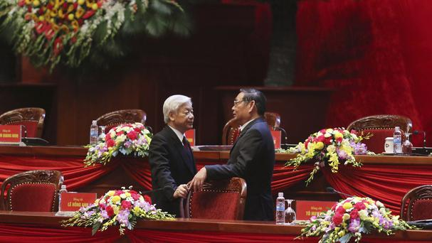 Vietnam Communist Party General Secretary Nguyen Phu Trong, and Party Secretary Le Hong Anh at the opening ceremony in Hanoi (AP)