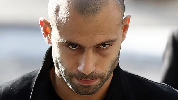 Barcelona defender Javier Mascherano leaves the court (AP)