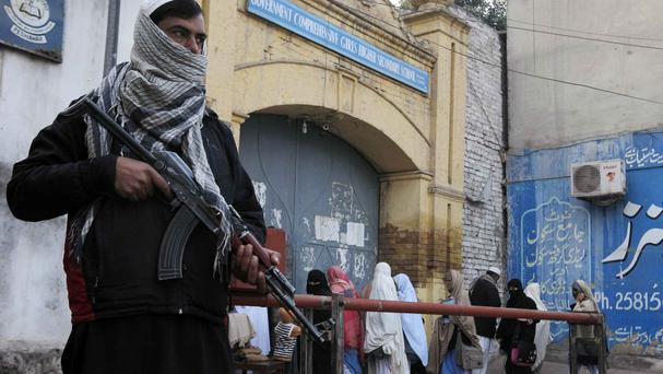 Security guards stand alert around schools and colleges following an attack on Bacha Khan University, in Peshawar, Pakistan. (AP)