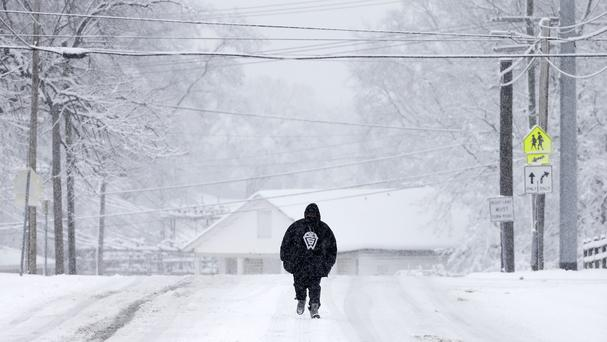 Snow covers a street in Nashville as a massive winter storm hits the US (AP)