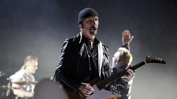 The Edge playing in Paris last month - the U2 guitarist is at the centre of a row over plans to build five mansions on a Malibu ridge (AP)