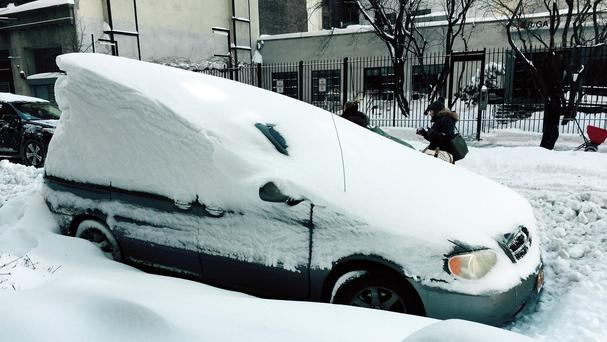The clear-up continues in New York City following the record-setting snowfall