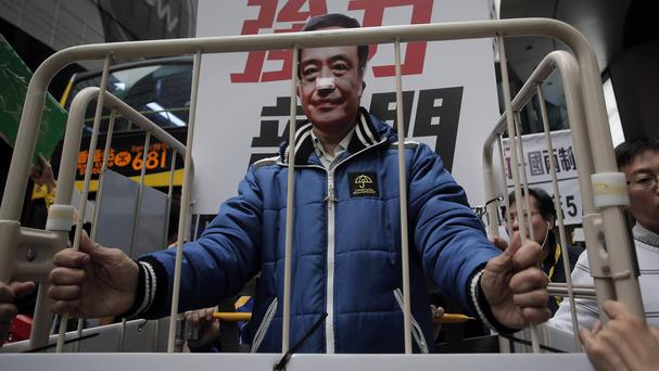 A protester wearing a mask of missing bookseller Lee Bo during a protest against his disappearance in Hong Kong on January 10 (AP)