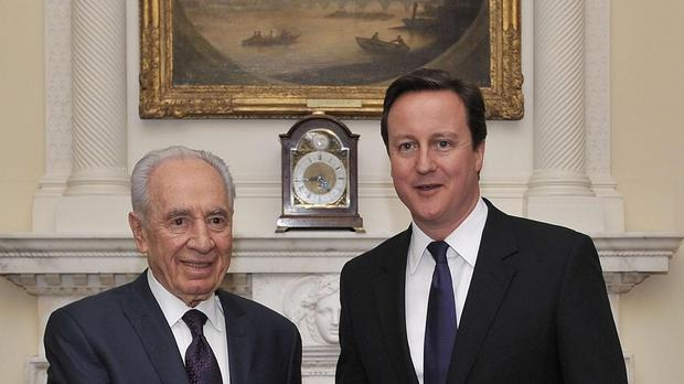 Shimon Peres pictured during a meeting with David Cameron