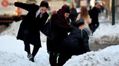 People try to navigate a snowbank in the middle of Park Avenue in New York yesterday. Photo: Getty