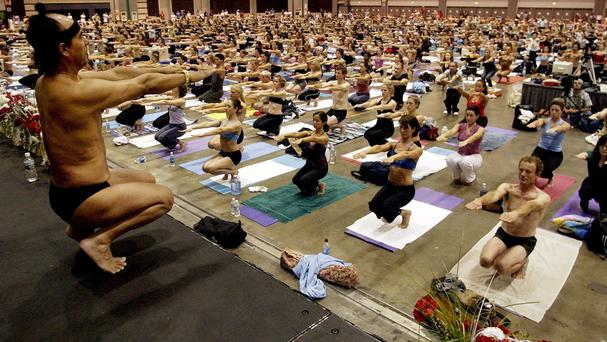 Bikram Choudhury leading a yoga class at the Los Angeles Convention Centre in 2003 (AP)